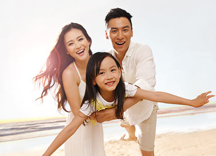 Parents on beach with daughter