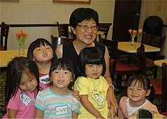 Lillian with group of kids